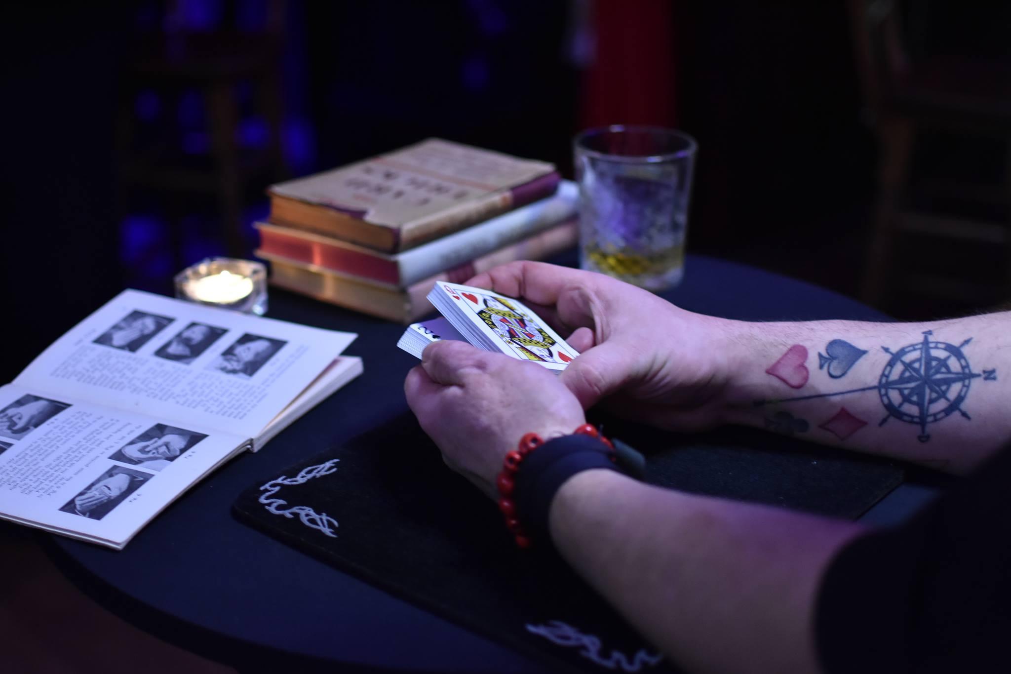 man doing a magic trick in bar magic