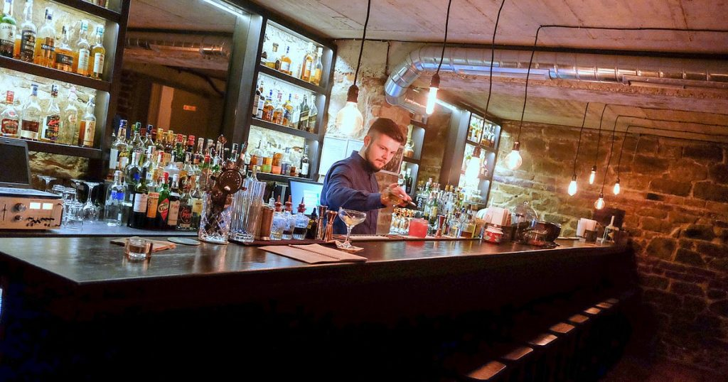 guy making cocktails at a bar