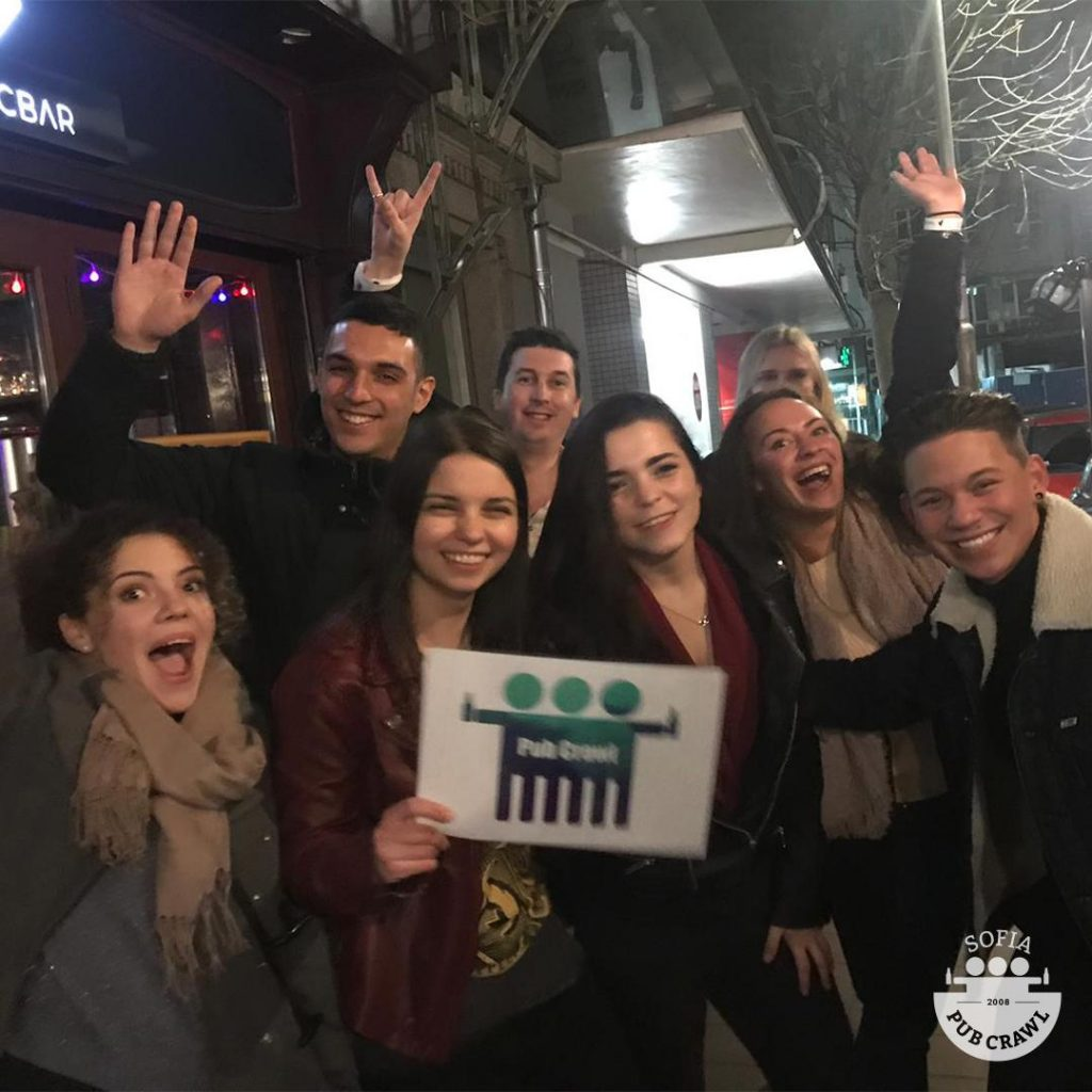 group of people on a bar crawl with sign