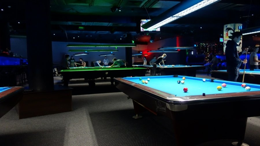 people playing pool in sofia at night