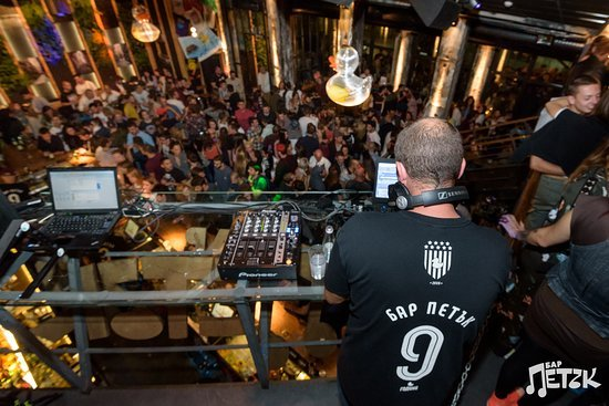 dj looking on a big crowd in club Petak