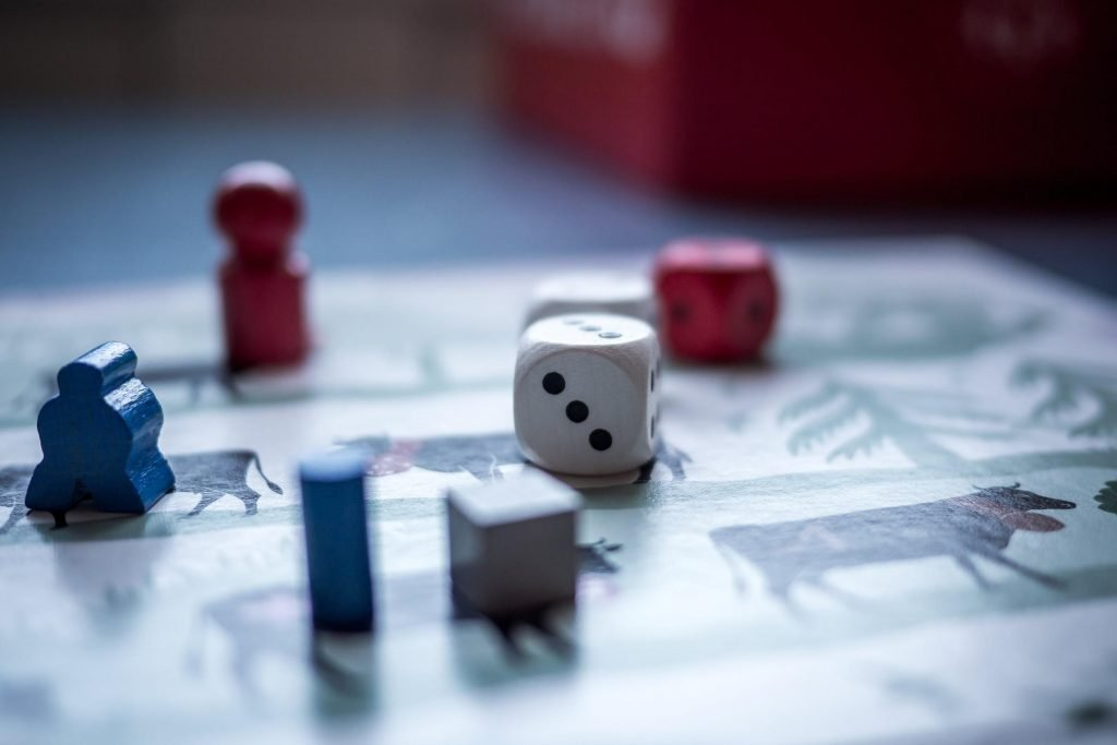 dice and figures on a boardgame