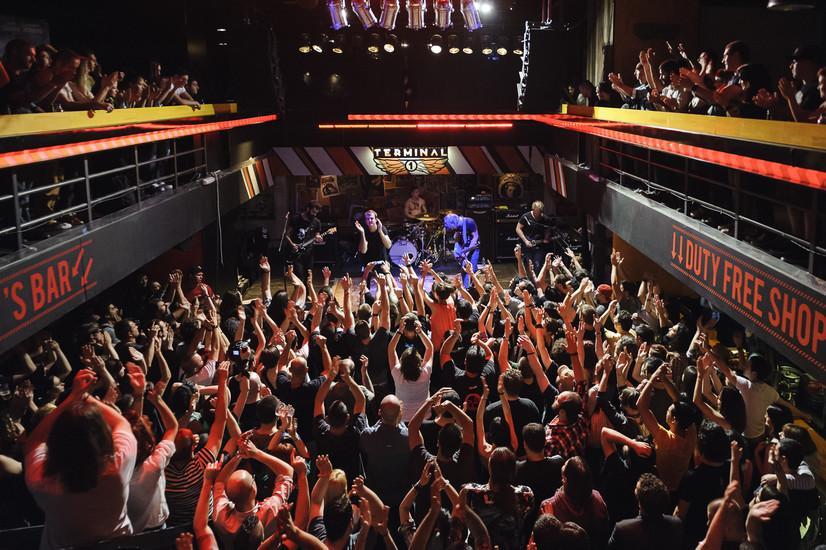 large crowd enjoying nightlife in club terminal 1