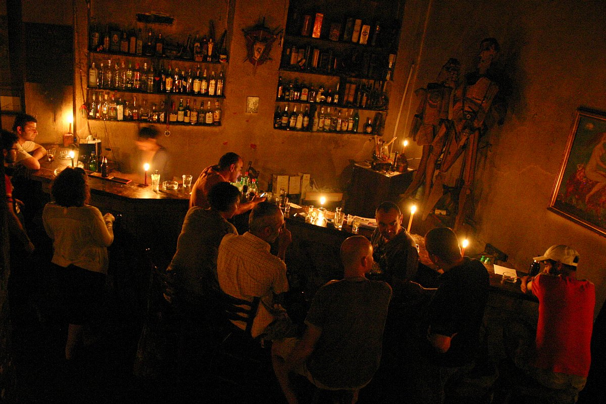 people sitting in a candlelit sofia bar