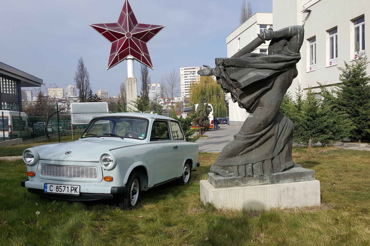 Sofia Tour of Communist history in a trabant next to a Soviet statue