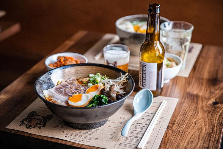 Ramen dish and beer in a Japanese restaurant in Sofia