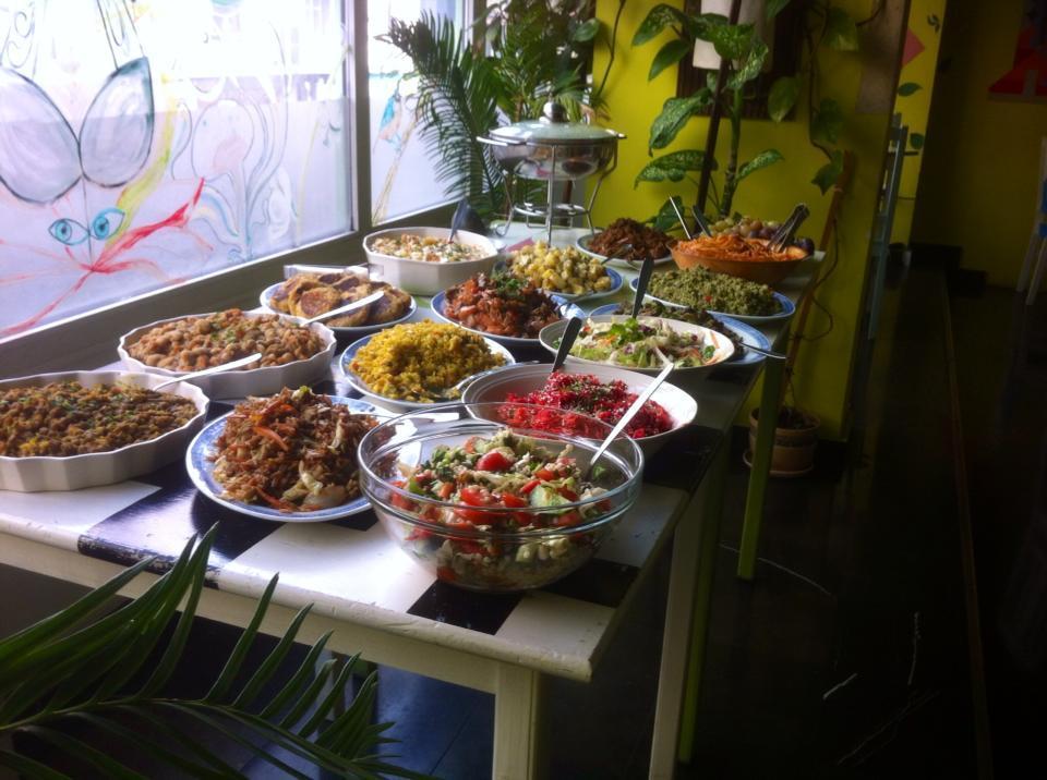 Big table of vegan and vegetarian dishes at a vegan/vegetarian restaurant